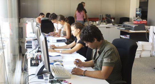 Colaboradores no escritório da Plan Architects